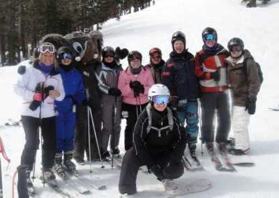 century city ski and snowboard club group shot on the slopes with the Mammoth mascot
